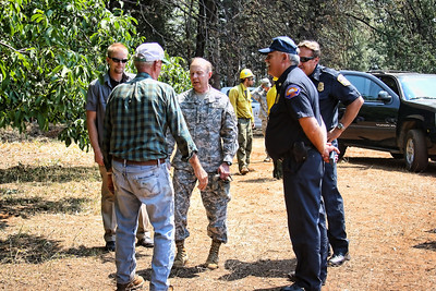 General Jacoby and VIPs from Interagency Incident Command and Cal Fire  talk with the local owner of the Church St. property.