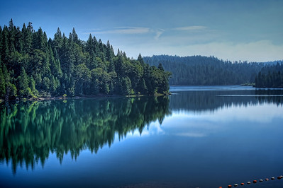 Sugar Pine Reservoir - the calm before the helicopter approaches.  Smoke in the background.