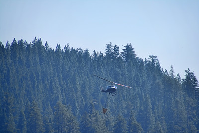 Helicopter loaded with water heading back to the fire