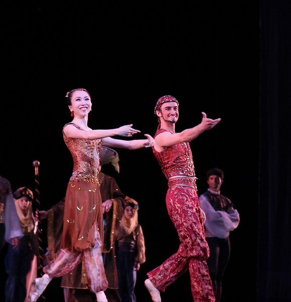 "Yuriko Kajiya and Jared Matthews, Le Corsaire, June 6, 2013 <br><br> I agree with The New York Times' dance critic <a href=""http://www.nytimes.com/2013/06/06/arts/dance/le-corsaire-american-ballet-theater.html?hpw&_r=0"">Alastair Macaulay</a> that ABT's Le Corsaire is frivolous and superficial, with a ridiculous, nonsensical comedic plot. However, unlike Macaulay, I thoroughly enjoy this ballet that showcases ABT's bravura dancing, having seen it more than dozen times over the past 15 years (Thursday and Friday performances this season).  <br><br> The plot goes something like this: Conrad the pirate (Thursday: Cory Stearns, Friday: Marcelo Gomes) arrives at a bazaar (in Turkey?) where slave girls are being traded. Lankendem (Thursday: Jared Matthews, Friday: Sascha Radetsky) owns the bazaar. Conrad sees Medora (Thursday: Veronika Part, Friday: Paloma Herrera) and immediately falls in love. The buffoon pasha buys Gulnare (Thursday: Yuriko Kajiya, Friday, Stella Abrera) and Medora. Conrad commands his slave Ali (Thursday: James Whiteside, Friday: Ivan Vasiliev) to steal Medora and Conrad's pirates kidnap Lankendem. <br><br> In Conrad's hideout, Medora tells Conrad, in the name of their love, to free all of the slave girls. He agrees, but his friend Birbanto (Thursday: Luis Ribagorda, Friday: Joseph Phillips) rebels against the idea and persuades the pirates to riot against Conrad. Conrad fights the pirates and convinces them to give up their mutinous plan. Birbanto's next scheme is to spray a rose with sleeping potion. Conrad is drugged to sleep. Birbanto attempts to capture Medora. She stabs him with a knife. In the confusion, Lankendem steals Medora back and escapes. <br><br> The pasha is happy that Medora has been recaptured and declares that she will be his number one wife. Medora is repulsed. Conrad, Birbanto, and the pirates storm the pasha's palace and chase away the pasha and his men. Medora then exposes Birbanto as a traitor; Conrad shoots him and then escapes to the ship. On ship, there is a terrible storm. The ship sinks. In the Epilogue, Conrad and Medora cling to a rock and offer ""…thanks for their miraculous survival, a testimony to the strength of their love.""  <br><br> The plot is silly with, as Macaulay notes, no link to the original Byron poem. However, there is a lot of dancing, and depending on the cast, a very high level of dancing with plenty of opportunity to see something exciting. With all this great dancing, why worry about a silly plot? <br><br> Regarding the dancing, Cory was a confident and outgoing Conrad Thursday evening, paired with Veronika Part. Cory has had a good season so far. I enjoyed him in the Shostakovich Trilogy in which he held his own with the Russian all-star team of Natalia Osipova, Ivan Vasiliev, and Diana Vishneva. I particularly like his double saute de basques, which have nice air time and horizontal distance from takeoff to landing, and his double assembles, fully on display on a nice diagonal with Vasiliev in Shostakovich (see the <a href=""http://www.abt.org/education/dictionary/index.html"">ABT ballet dictionary</a> for a description and video of the steps). Marcelo Gomes' performance Friday night brought a new level of enthusiasm to the role, as his excitement during his bows after his solos in anticipation of Medora clearly showed. <br><br> Veronika Part radiated beauty during her barzaar entrance in which Conrad immediately fell in love. She has a long, beautiful, elegant line; a bit off on some of her turns in the first act but she pulled off the demanding fouette series in the second act. Paloma Herrera was in good form as Medora on Friday.  <br><br> Ali the Slave doesn't do much in this ballet except for the dance with Medora and Conrad at the opening of the second act. Ivan Vasiliev was amazing on Friday night; if there is a better dancer in this role today, let me know. His dancing style is all-out, full  throttle all the way, but with very controlled turns on Friday. His solo was similar to this <a href=""http://www.youtube.com/watch?v=vXh3Wl08mW4  "">YouTube clip.</a> Notable are his forever hanging double pas de chat  sequence (4:30), a funky step that I can't begin to describe (4:41), nice controlled turns in attitude (4:54), very unique innovation on his double saute de basques (5:07) in which he shoots out his lead leg in a sweeping motion, 540 trick at 7:53, double assemble sequence at 8:00, and a nice turn sequence with pirouettes a le second followed by four turns in second, finished by multiple controlled turns at 9:07.  <br><br> I also liked Ivan's dancing in Shostakovich Trilogy but don't think his style, gymnast body type, and line mesh well in more classical pieces such as Symphony in C. <br><br> James Whiteside was the slave on Thursday night. He is a former Boston Ballet Principal Dancer in his first season at ABT. His solo was a standard version, with very high diagonal split jumps. His pirouettes are very fast with arms tightly wrapped, the opposite of Jose Manuel Carreno. This was the first time I've seen him dance. It must be a nerve wracking experience doing the slave for the first time at the Met, but thought he pulled it off. <br><br> Corps members Luis Ribagorda (Thursday) and Joseph Phillips (Friday) played the role of Birbanto. Phillips impressed me in the role of the gypsy in Don Quixote and look forward to seeing him again. Nice to see that corps members are getting starring roles at ABT. Blogger <a href=""http://haglundsheel.typepad.com/haglunds_heel/2013/04/abt-big-debuts-413.html "">Haglund</a> reviews ABT's Washington Le Corsaire and was particularly impressed with Ribagorda and Phillips.  <br><br> This year's production features new costumes by Anaibal Lapiz. I am happy that Lankendem's old costume that looked like pajamas that my 9-year old would wear has been retired. Macaulay calls the bikini tutus that the slave girls wear his least favorite form of dance apparel. I actually like the look, particularly on Simone Messmer, Luciana Paris, Isabella Boylston (Thursday night), Melanie Hamrick, Kristi Boone, Leann Underwood (Friday night). Any more comments on bikini tutus and I might get into trouble. <br><br> Although the orchestra area was full Thursday, audience response was muted during the curtain calls. The Friday cast received a more enthusiastic response."
