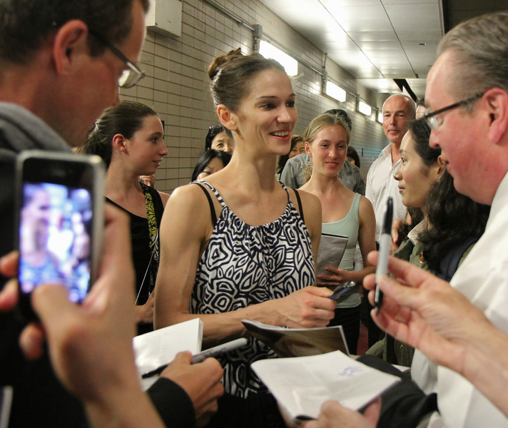Polina Semionova, Sylvia, June 28, 2013<br /> <br /> Polina meets her fans after the performance at Lincoln Center<br /> <br /> I had extra time after the Friday performance and stopped by the door where the dancers exit in the underground parking lot at Lincoln Center. I heard that some fans linger for an opportunity to see their favorite dancers and wanted to see what it was all about. <br /> <br /> There were about 30-50 people milling about Friday evening. Polina came out about 20 minutes after the performance to a large ovation. She was very gracious and patient, posing with her fans and signing numerous autographs.<br /> <br /> Roberto came out about 10 minutes later and was particularly considerate and cordial. Some wanted an autograph, photo, or a brief chat-essentially an additional connection with him after a great performance. After satisfying all of the demands of his fans, he waved goodbye and slowly walked away into the Manhattan evening.
