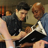 Roberto Bolle, Sylvia, June 28, 2013<br /> <br /> Roberto autographs a book for a fan<br /> <br /> I had extra time after the Friday performance and stopped by the door where the dancers exit in the underground parking lot at Lincoln Center. I heard that some fans linger for an opportunity to see their favorite dancers and wanted to see what it was all about. <br /> <br /> There were about 30-50 people milling about Friday evening. Polina came out about 20 minutes after the performance to a large ovation. She was very gracious and patient, posing with her fans and signing numerous autographs.<br /> <br /> Roberto came out about 10 minutes later and was particularly considerate and cordial. Some wanted an autograph, photo, or a brief chat-essentially an additional connection with him after a great performance. After satisfying all of the demands of his fans, he waved goodbye and slowly walked away into the Manhattan evening.