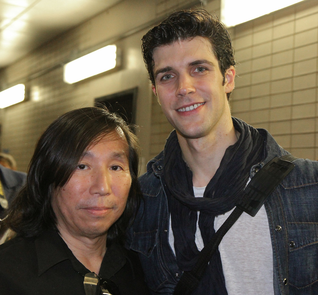 Roberto Bolle, Sylvia, June 28, 2013<br /> <br /> Roberto poses for a photo with a fan from New Haven, CT<br /> <br /> I had extra time after the Friday performance and stopped by the door where the dancers exit in the underground parking lot at Lincoln Center. I heard that some fans linger for an opportunity to see their favorite dancers and wanted to see what it was all about. <br /> <br /> There were about 30-50 people milling about Friday evening. Polina came out about 20 minutes after the performance to a large ovation. She was very gracious and patient, posing with her fans and signing numerous autographs.<br /> <br /> Roberto came out about 10 minutes later and was particularly considerate and cordial. Some wanted an autograph, photo, or a brief chat-essentially an additional connection with him after a great performance. After satisfying all of the demands of his fans, he waved goodbye and slowly walked away into the Manhattan evening.