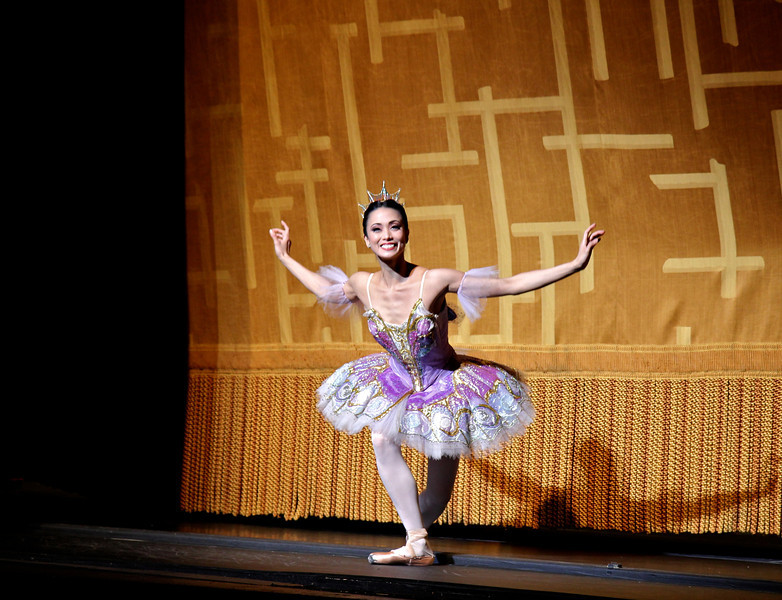 Stella Abrera, Sleeping Beauty, July 6, 2013<br /> <br /> Veronika Part was spectacular as Aurora in ABT's final Met performance of 2013 of Sleeping Beauty. From the moment she appeared on the balcony and descended the stairs to join her 16th birthday party, Veronika took command of the stage with energy, confidence, and style with precise technique and grace, taking full advantage of her long, pure, elegant line and nice turnout and extension. I have not seen Aurora performed this well in a long time. <br /> <br /> Veronika performed the difficult Rosa Adagio nicely with great control and confidence. Some dancers perform this adagio well but with a nervous look of an impending root canal; from my vantage point she did not display any anxiety before or during the adagio. During her balances, she raised her arms to fifth en haut (arms above her head) with a pause before placing her hand down to her next prince. Some dancers do not raise their arms to fifth position, but quickly and anxiously grab the hand of the next partner in desperation. Not Veronika as there were no rough edges Saturday evening. After the adagio in the forest scene, she performed a nice solo with ronde de jambe to a jete diagonal that was uniquely done. Also notable during the pas de deux solo was the way she moved her hands in sync to the beautiful music. <br /> <br /> Marcelo Gomes perfectly complemented Veronika as Prince Desire. He also has a nice long line and great extension. He is a perfect prince as he showered attention to his new love, beaming in admiration. He partnered her effortlessly throughout and his solos were also graceful with nice deep plies ending in a tight fifth position on his tours and jumps. He makes dancing look very easy, a sign of a great dancer. <br /> <br /> Stella Abrera was also very good as the Lilac Fairy. She was particularly convincing in Act II when she convinces Prince Desire to stay in the mysterious forest by granting him a vision of Aurora's beauty. With the Lilac Fairy's help, the prince defeats the evil Carabosse (Martine Van Hamel) and awakens Aurora with a kiss and the spell is broken. The three dancers do a remarkable job describing the story with expressive gestures and mime.<br /> <br /> I was happy to see Misty Copeland as Princess Florine in the Bluebird pas de deux with Blaine Hoven, I haven't seen Misty dance much this year; she was light, energetic, and airy as a bird. Blaine did a fine brise vole beat diagonal that epitomizes the Bluebird solo, capped off by double tours with arms in fifth en haut (arms raised above his head). <br /> <br /> Sad to see the ABT season end. I hope you enjoyed my curtain call photographs and commentary. I make the photos available through a Creative Commons copyright. You may use the photos for non-commercial purposes such as blog posts, Facebook posts, tweets, etc as long as you provide attribution to my website. Wouldn't a photo of Roberto, Marcelo, or Veronika make a nice desktop background photo on your computer? You can't beat the price (free). I will now focus on houses of worship and landscapes in the short term; longer term, maybe a dance/photography blog. I will keep you posted on Twitter. Thanks for tuning in. Kent