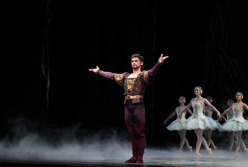 """Ivan Vasiliev as Rothbart, Swan Lake, June 22, 2013 <br><br> Attending ABT's Swan Lake is like going to a familiar Columbus Avenue restaurant in Manhattan; not much suspense or surprises as the menu rarely changes. In Saturday evening's performance there were two menu changes that caught my eye: Cory Stearns as Prince Siegfried and Ivan Vasiliev as the evil von Rothbart. Cory has been dancing leading roles since his promotion to Principal Dancer in 2011.  I enjoyed his Don Q and his Conrad in Le Corsaire earlier this season. Ivan was great as Ali the Slave in Le Corsaire and in Shostakovich Trilogy, but his Symphony in C fell flat for me.  <br><br> Cory was a gallant and expressive prince Saturday night. His face lit up like a immature boy on Christmas day when the Queen Mother (Karen Uphoff) presented him with a crossbow at his coming of age birthday; soon after he realizes his youth and carefree days are numbered when the Queen reminds him that, as a King, he must choose a bride at the ball. It is time for Prince Siegfried to get serious.  <br><br> Cory's dancing this year generally impresses me. He is very controlled and never pushes too hard. He has deep soft plies ending his double tours. His turns are nicely paced, never pushing for just one last turn to impress the audience. On his turn sequence in the pas de deux, he performed alternating single and double turns in second, finally pulling for four pirouettes finishing on relevé. Paloma's dancing was smooth as it was clear that she has done this role before. Cory and Paloma connected well as Cory was in awe of this swan.   <br><br> Ivan is a polarizing dancer; some people love his dancing and some hate his acrobatic, bravura style, with his gymnast body type. I am generally in the former camp because Ivan can do things that very few dancers in the world can do. <a href=""""http://www.youtube.com/watch?v=WQOdC1YyKpM"""">Here is one example:</a> a slow motion YouTube video from rehearsal of him doing a triple cabriol"""