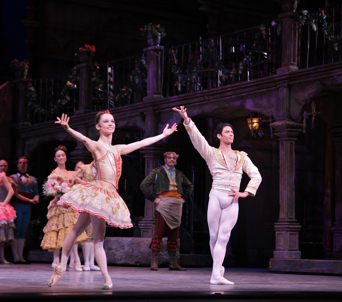 """Maria Kochetkova and Herman Cornejo, Don Quixote, May 15, 2014 <br><br> I'm always excited at the beginning of every ABT season, anticipating the great performances that lie ahead. While New York City Ballet presents important choreography from Balanchine and Robbins with dancers as somewhat interchangeable parts, ABT's Spring Met season is a celebration of individual technical achievement set to ballets that sometimes do not meet the approval of critics (see New York Times reviews from dance critics <a href=""""http://www.nytimes.com/2013/07/08/arts/dance/american-ballet-theater-presents-sleeping-beauty.html?_r=0"""">Alastair Macaulay</a> and <a href=""""http://www.nytimes.com/2014/05/15/arts/dance/american-ballet-theater-performs-don-quixote.html"""">Gia Kourlas</a>). ABT's repertory is fodder for critics complaining of mind numbing """"warhorse"""" ballets fulfilling lowbrow consumer tastes. However, few people care. ABT audiences are not searching for subtle choreographic interpretation or the meaning of life. They're looking to see bravura dancing at its finest, with the story a backdrop for the dancing. <br><br> Full throttle bravura dancing was on display Thursday evening with Herman Cornejo and Maria Kochetkova as leads. Herman is a rare, once-in-a-lifetime talent, a master of his craft at the peak of his powers. The ballet showed off his turning skills as he regularly ripped off 6-7 turns, many with one hand on his hip and some ending in a double tour to the knee. In the second act, he had a nice diagonal consisting of four consecutive double saut de basques. He played an energetic but at times subdued Basilio. <br><br> His partner was San Francisco Ballet Principal Dancer Maria Kochetkova. They make a nice pair as he is 5'6 and she stands at 5 feet tall and light as a feather. Her small frame came in handy in the one-handed lifts, where he held her over his head for over five seconds. She had an impressive diagonal of turns in first position, alternating single and double p"""