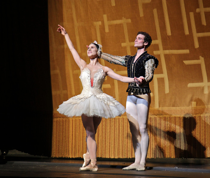 """Paloma Herrera and Cory Stearns, Swan Lake, June 22, 2013 <br><br> Attending ABT's Swan Lake is like going to a familiar Columbus Avenue restaurant in Manhattan; not much suspense or surprises as the menu rarely changes. In Saturday evening's performance there were two menu changes that caught my eye: Cory Stearns as Prince Siegfried and Ivan Vasiliev as the evil von Rothbart. Cory has been dancing leading roles since his promotion to Principal Dancer in 2011.  I enjoyed his Don Q and his Conrad in Le Corsaire earlier this season. Ivan was great as Ali the Slave in Le Corsaire and in Shostakovich Trilogy, but his Symphony in C fell flat for me.  <br><br> Cory was a gallant and expressive prince Saturday night. His face lit up like a immature boy on Christmas day when the Queen Mother (Karen Uphoff) presented him with a crossbow at his coming of age birthday; soon after he realizes his youth and carefree days are numbered when the Queen reminds him that, as a King, he must choose a bride at the ball. It is time for Prince Siegfried to get serious.  <br><br> Cory's dancing this year generally impresses me. He is very controlled and never pushes too hard. He has deep soft plies ending his double tours. His turns are nicely paced, never pushing for just one last turn to impress the audience. On his turn sequence in the pas de deux, he performed alternating single and double turns in second, finally pulling for four pirouettes finishing on relevé. Paloma's dancing was smooth as it was clear that she has done this role before. Cory and Paloma connected well as Cory was in awe of this swan.   <br><br> Ivan is a polarizing dancer; some people love his dancing and some hate his acrobatic, bravura style, with his gymnast body type. I am generally in the former camp because Ivan can do things that very few dancers in the world can do. <a href=""""http://www.youtube.com/watch?v=WQOdC1YyKpM"""">Here is one example:</a> a slow motion YouTube video from rehearsal of him doing a triple c"""