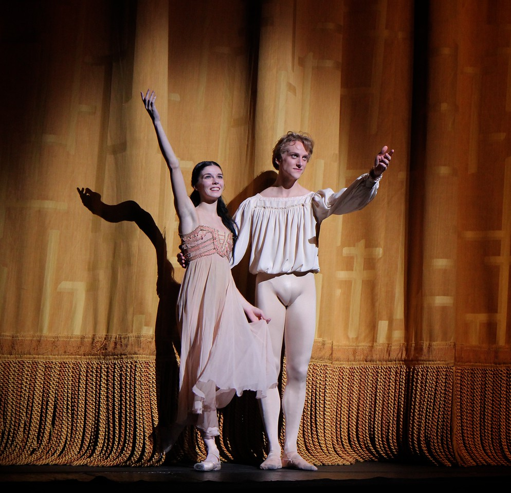 "Natalia Osipova and David Hallberg, Romeo and Juliet, June 14, 2013 <br><br> I thoroughly enjoyed ABT's Romeo and Juliet on Friday, June 14 with Natalia Osipova as Juliet, David Hallberg as Romeo, Jared Matthews as Mercutio, Joseph Gorak as Benvolio, and Patrick Ogle as Tybalt. I haven't seen Osipova in a dramatic role before and was impressed by her portrayal of the evolution of Juliet; in Act 1 Scene 2 she is a young, playful, immature little girl who gasps in amazement when the nurse points out her developing physique. Fast forward to Act III Scene 1. This is a particularly heavy scene as she refuses to marry Paris (Sascha Radetsky). She does a bourrée quickly away from him, much to the displeasure of her parents that threaten to disown her. In Osipova, there are traces of Giselle's mad scene as the tension mounts as she rejects Paris and faces the severe consequences.   <br><br> Hallberg portrays a playful, rebellious young man thoroughly transformed by his love of Juliet. He was in tune with MacMillan's vision of Romeo as a young man swept off his feet by love, dancing in dizzy exultation. As usual, his dancing was solid and always in character, showcasing his long line and perfectly arched feet.  Although a dramatic ballet, it has a number of technical elements that maintain my interest such as Hallberg's nice double sauté de basque diagonal repeated effortlessly four times. The balcony scene pas de deux was intense and dramatic as the young lovers celebrate their union with reckless abandon. Osipova is criticized for her excessive expressiveness (mugging it up); I did not detect this trait and thought her portrayal of Juliet was always in character.  <br><br> I was particularly impressed with Jared Matthews as Mercutio and Joseph Gorak as Benvolio. After seeing Gorak in Drink to Me Only With Thine Eyes earlier this season, I asked the woman next to me ""Who is that guy?"" He has nice extension and turns and I ended up watching him more than the others in the Pas de trois. I liked Matthews as Mercutio more than his Conrad in Le Corsaire. His assemble combination, split jump over Hallberg's head in the party scene, and turns with an indifferent wobble of the head were particularly notable Friday night. His dying Mercutio was performed well; it must be difficult to dance proficiently while portraying a dying person running out of breath and energy. <br><br> It was a packed Met Opera house Friday night without any empty seats in the orchestra. The dancers received multiple enthusiastic curtain calls. <br><br> Kenneth MacMillan's version of Romeo and Juliet was first performed by The Royal Ballet in 1965 and entered ABT's repertory in 1985. According to a website by <a href=""http://www.kennethmacmillan.com/ballets/all-works/1960-1966/romeo-and-juliet.html"">MacMillian's estate,</a> MacMillan had wanted to create his own Romeo and Juliet after seeing John Cranko's version for the Stuttgart Ballet. Lynn Seymour performed the role of Juliet in 1964 and MacMillan choreographed the balcony scene for her and Christopher Gable to perform on Canadian television. The Royal Ballet wanted a new three-act ballet to commemorate the 400th anniversary of Shakespeare; The Royal Ballet artistic director Frederick Ashton contracted MacMillan to complete the ballet in less than five months to include on its 1965 American tour. This was MacMillan's first three-act ballet.  <br><br> MacMillan first choreographed the key pas de deux in each act, which was the starting point which the rest of the ballet would be built. MacMillan, Seymour, and Gable worked on the characters in the ballet. MacMillan and Seymour created a headstrong, passionate Juliet who makes many of the key decisions such as the secret marriage, taking Friar Lawrence's potion, and joining Romeo in death. Gable's Romeo was a young man swept off his feet by love, dancing in dizzy exultation according to the website. <br><br> The website says that MacMillan avoided virtuoso steps because he thought they were too conventionally balletic. Only Juliet and her girlfriends are on point and their choreography is contrasted with character dances and crowd scenes. ""MacMillan broke the ballet conventions of the time by having the dancing evolve from naturalistic action. Unlike Cranko's production, there are no picturesque poses for applause at the end of set pieces. Unlike the Bolshoi production, there are no spotlit entrances for the leading characters: Romeo is discovered in semi-darkness at the start of the ballet as Rosaline's anonymous suitor; Juliet's arrival at the ball in her honour goes unnoticed at first."" I note this last point because I can't remember Osipova's entrance Friday evening. <br><br> At the end of the ballet, there is no reconciliation of the Montagues and Capulets in the manner that Shakespeare ended his tragedy.  Margot Fonteyn and Rudolf Nureyev starred in the premier, which had 43 curtain calls. The safety curtain was brought down to persuade the audience to leave. Fonteyn and Nureyev performed in the premier because they were a bigger draw than Seymour and Gable. The ballet received rave reviews. The pair went on to perform in the U.S. tour and film of the ballet. It is interesting to note that the late former ABT ballet mistress Georgina Parkinson was in the original cast.  <br><br> Romeo and Juliet is the signature work of The Royal Ballet's repertoire. During his lifetime, MacMillan staged the ballet for The Royal Swedish Ballet in 1971, ABT in 1985, and Birmingham Royal Ballet in 1992."