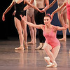 "Tiler Peck, Symphony in Three Movements, October 4, 2013<br /> <br /> When going through my tickets for the New York City Ballet fall season a few weeks ago, I was at first disappointed to see that two of the performances were of the same program, Balanchine in Black & White. However, after seeing the performance last Saturday (see my review from September 29) filled with Balanchine's complexity and nuance, I valued the opportunity to see the program-consisting of The Four Temperaments, Episodes, Duo Concertant, and Symphony in Three Movements, again Friday night with a different cast.<br /> <br /> In The Four Temperaments, I particularly enjoyed Gonzalo Garcia in the Melancholic variation. His dancing flowed with the beautiful Paul Hindemith music as he displayed a substantial dramatic flair portraying a lost and anguished soul. His exit with an exaggerated arched back walking backwards was a dramatic conclusion.<br /> <br /> I also liked Ana Sophia Scheller in the Sanguinic variation with Jared Angle. She had a nice split jete section followed by turns that were well executed. Teresa Reichlen performed the Choleric variation, which was a bit more subdued relative to the frenetic energy provided by Ashley Bouder last Saturday. In one section that I enjoyed, Reichlen danced with four men. After the men had had enough of dancing with the choleric representation, they left the stage to be replaced by four women. The four women formed a square surrounding Reichlen. The four danced a short variation as Reichlen was frozen. The four dancers then paused as Reichlen danced a short variation in the middle of the square. They then danced in unison.<br /> <br /> In Episodes, Savannah Lowery and Amar Ramasar danced the ""spotlight"" variation, Five Pieces, Opus 10 by Anton von Webern. They entered on opposite sides of a diagonal lit in spotlights as he was in all black while she was in an all white leotard. The pas de deux was dramatic and tense throughout, with a sense of conflict between the two. I also liked Rebecca Krohn in the more melodic section set to Bach's Musical Offering.<br /> <br /> Sterling Hyltin and Robert Fairchild were on the mark in Duo Concertant, a happy, upbeat pas de deux in which the dancers interact with violist Arturo Delmoni and pianist Cameron Grant on stage. The piece has a sense of humor; in one section when he offered his hand to her, she shaked her head ""No"" and laughed at him. The footwork here was very fast and they were able to keep up with the rapid tempo. Fairchild had a rapid single tour section in which he threw singles in rapid-fire succession; she had a quick piqué turn section. As I noted in my previous review, the piece ends in near darkness as she walks away, then returns and their hands embrace, lit dramatically by a single spotlight.<br /> <br /> Tiler Peck, deviating from the theme of the evening in a pink leotard, was particularly noteworthy in Symphony in Three Movements with rapid piqué turns and energetic leaps; she tired me out watching her. She was partnered well by soloist Taylor Stanley."