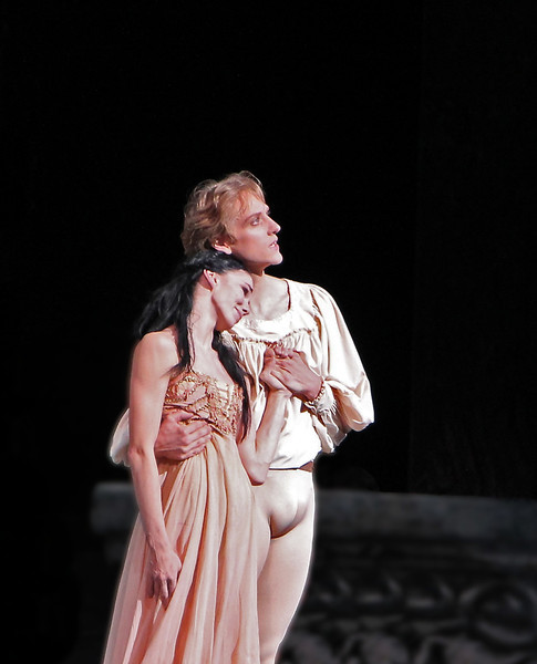 """Natalia Osipova and David Hallberg, Romeo and Juliet, June 14, 2013 <br><br> I thoroughly enjoyed ABT's Romeo and Juliet on Friday, June 14 with Natalia Osipova as Juliet, David Hallberg as Romeo, Jared Matthews as Mercutio, Joseph Gorak as Benvolio, and Patrick Ogle as Tybalt. I haven't seen Osipova in a dramatic role before and was impressed by her portrayal of the evolution of Juliet; in Act 1 Scene 2 she is a young, playful, immature little girl who gasps in amazement when the nurse points out her developing physique. Fast forward to Act III Scene 1. This is a particularly heavy scene as she refuses to marry Paris (Sascha Radetsky). She does a bourrée quickly away from him, much to the displeasure of her parents that threaten to disown her. In Osipova, there are traces of Giselle's mad scene as the tension mounts as she rejects Paris and faces the severe consequences.   <br><br> Hallberg portrays a playful, rebellious young man thoroughly transformed by his love of Juliet. He was in tune with MacMillan's vision of Romeo as a young man swept off his feet by love, dancing in dizzy exultation. As usual, his dancing was solid and always in character, showcasing his long line and perfectly arched feet.  Although a dramatic ballet, it has a number of technical elements that maintain my interest such as Hallberg's nice double sauté de basque diagonal repeated effortlessly four times. The balcony scene pas de deux was intense and dramatic as the young lovers celebrate their union with reckless abandon. Osipova is criticized for her excessive expressiveness (mugging it up); I did not detect this trait and thought her portrayal of Juliet was always in character.  <br><br> I was particularly impressed with Jared Matthews as Mercutio and Joseph Gorak as Benvolio. After seeing Gorak in Drink to Me Only With Thine Eyes earlier this season, I asked the woman next to me """"Who is that guy?"""" He has nice extension and turns and I ended up watching him more than the others in the Pa"""