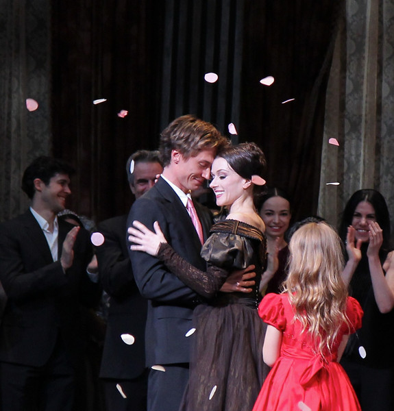 Irina Dvorovenko and Maxim Beloserkovsky, Irina's Final ABT Performance, May 18, 2013<br /> <br /> Irina embraces husband Max as daughter Emma looks on in the post performance celebration of Irina's final ABT performance. <br /> <br /> It was an honor to be at Irina's final ABT performance, as Tatiana in Onegin. I always enjoyed watching Irina since she joined ABT in 1996, so it was sad to see her go. She was always expressive when dancing diverse roles-from a cocky, coquettish Kitri in Don Quixote to an anguished young lover in Romeo and Juliet. I enjoyed her great athleticism typified by a fouetté sequence in Don Quixote consisting of a series of alternating single and double fouettés with the double pirouettes capped by one arm en haut (arm above head) holding a Spanish fan. Her performances with husband Maxim Beloserovsky were memorable; you could see the great affection and bond between the two from the audience. <br /> <br /> Here are photos from Irina's emotional post-performance goodbye. Plenty of hugs and tears as Irina is congratulated on a great ABT career by current and former dancers in addition to a well-deserved goodbye from her many adoring fans.<br /> <br /> I had an event in Philadelphia that weekend but wasn't going to miss Irina's final performance even if it meant taking the 3 am Amtrak train back to Philadelphia. Well worth the lack of sleep.