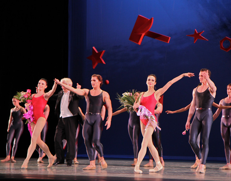 "Natalia Osipova, Ivan Vasiliev, Diana Vishneva, and Cory Sterns, Shostakovich Trilogy, June 1, 2013<br /> <br /> Alexei Ratmansky's Shostakovich Trilogy is an exciting, complex, multifaceted work with never a dull moment. Trilogy premiered on Friday, May 31, 2013.  I saw the premier and the Saturday evening performance, which had the same cast. There is a lot going on in the three pieces and it would be difficult to take in all of the action with just one viewing.  I look forward to seeing it in future seasons as even two viewings is not enough to absorb all of the nuances in this fast-paced ballet. Ratmansky's stage is a busy one, with dancers constantly darting in and out of the action, with changing groups and combinations of dancers. <br /> <br /> The work consists of three seemingly unrelated pieces; if they are related, I missed the linkage. The first is Symphony #9, which premiered at City Center in October 2012. The scenery by George Tsypin consists of drawings of World War I-type airplanes, blimps, and  people, some carrying red flags. The two performances I saw featured Polina Semionova and Marcelo Gomes, Herman Cornejo, and Simone Messmer and Craig Salstein. Polina and Marcelo are a great pair and perfectly matched-I saw them in Symphony in C  earlier in the 2013 season. She is becoming one of my favorites at ABT. There are several lighter moments in their dancing with playful movements, demonstrating a sense of humor from Ratmansky. Herman is incredible; in one notable section he performs multiple entrechat six (six beats), each very clean with clear leg separation on the first two leg crossings (four beats), with an exaggerated separation on the last crossing. Very nice. He continues the beats while jumping to stage right and off the stage. Craig Salstein is very expressive and adds a slightly comedic touch. <br /> <br /> The second piece is Chamber Symphony and features David Hallberg-dressed in a jacket with no shirt-as a lost, tormented soul, desperately searching for something. He moves frenetically around the stage sometimes brushing his hair out of his eyes as he tries to connect with Isabella Boyston, Paloma Herrera, and Julie Kent. The program provides no guidance on the story. I talked to someone after the performance; he said that at a rehearsal, Hallberg's character was disclosed as Shostakovich and the three women represent his three wives. I checked Wikipedia and Shostakovich was married three times. The first marriage had difficulties and ended in divorce. The third marriage was to a much younger woman, ""her only defect is that she is 27 years old. In all other respects she is splendid: clever, cheerful, straightforward and very likeable."" I addition, he survived Stalin's Great Terror while many of his friends and relatives were imprisoned or killed. There are three male dancers dancing in harsh tones, possibly representing threats to Shostakovich from NKVD Soviet Police.<br /> <br /> I found the piece interesting, but wanted more background-who are these women and why is Hallberg's character so frantic and lost? What is he searching for? Not knowing much about Shostakovich, I was a bit lost without any context. Background information in the program such as the detail provided in the rehearsal would have been helpful. <br /> <br /> The third piece, Piano Concerto #1,  is my favorite and features two couples: Natalia Osipova and Ivan Vasiliev, and Diana Vishneva and Cory Stearns. The dancers' bodies are clearly on display as the males wore  unitards (costumes by Keso Deeker) with the females wearing red leotards. Cory and Ivan had greased, slicked-back hair (I didn't recognize Cory on Friday with that look). The scenery consisted of red objects hung in suspension. Some of the objects reminded me of the Soviet hammer and sickle. <br /> <br /> Plenty of non-stop action in this one with the four main dancers appearing in various combinations. Diana and Natalia danced well together and complement each other given their similar physiques. I particularly liked a spectacular double assemble diagonal from Ivan and Cory that drew much applause. Natalia had a grande jete diagonal section in which she seemed to fly. <br /> <br /> I loved the Trilogy and want to see it again in future seasons. I generally have a desire to see multiple casts, but was not disappointed to see the same cast in two consecutive nights given the high level of dancing. I couldn't see many empty seats on either night and the audience seemed to enjoy the performance. I guess that's why ABT wisely hired Ratmansky in the first place."