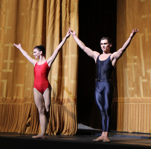 Natalia Osipova and Ivan Vasiliev, Shostakovich Trilogy, June 1, 2013<br /> <br /> Alexei Ratmansky's Shostakovich Trilogy is an exciting, complex, multifaceted work with never a dull moment. Trilogy premiered on Friday, May 31, 2013.  I saw the premier and the Saturday evening performance, which had the same cast. There is a lot going on in the three pieces and it would be difficult to take in all of the action with just one viewing.  I look forward to seeing it in future seasons as even two viewings is not enough to absorb all of the nuances in this fast-paced ballet. Ratmansky's stage is a busy one, with dancers constantly darting in and out of the action, with changing groups and combinations of dancers. <br /> <br /> The work consists of three seemingly unrelated pieces; if they are related, I missed the linkage. The first is Symphony #9, which premiered at City Center in October 2012. The scenery by George Tsypin consists of drawings of World War I-type airplanes, blimps, and  people, some carrying red flags. The two performances I saw featured Polina Semionova and Marcelo Gomes, Herman Cornejo, and Simone Messmer and Craig Salstein. Polina and Marcelo are a great pair and perfectly matched-I saw them in Symphony in C  earlier in the 2013 season. She is becoming one of my favorites at ABT. There are several lighter moments in their dancing with playful movements, demonstrating a sense of humor from Ratmansky. Herman is incredible; in one notable section he performs multiple entrechat six (six beats), each very clean with clear leg separation on the first two leg crossings (four beats), with an exaggerated separation on the last crossing. Very nice. He continues the beats while jumping to stage right and off the stage. Craig Salstein is very expressive and adds a slightly comedic touch. <br /> <br /> The second piece is Chamber Symphony and features David Hallberg-dressed in a jacket with no shirt-as a lost, tormented soul, desperately searching for something. 