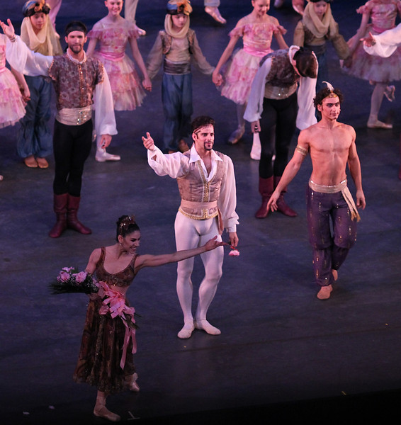 """Paloma Herrera, Marcelo Gomes, Ivan Vasiliev, Le Corsaire, June 7, 2013 <br><br> I agree with The New York Times' dance critic <a href=""""http://www.nytimes.com/2013/06/06/arts/dance/le-corsaire-american-ballet-theater.html?hpw&_r=0"""">Alastair Macaulay</a> that ABT's Le Corsaire is frivolous and superficial, with a ridiculous, nonsensical comedic plot. However, unlike Macaulay, I thoroughly enjoy this ballet that showcases ABT's bravura dancing, having seen it more than dozen times over the past 15 years (Thursday and Friday performances this season).  <br><br> The plot goes something like this: Conrad the pirate (Thursday: Cory Stearns, Friday: Marcelo Gomes) arrives at a bazaar (in Turkey?) where slave girls are being traded. Lankendem (Thursday: Jared Matthews, Friday: Sascha Radetsky) owns the bazaar. Conrad sees Medora (Thursday: Veronika Part, Friday: Paloma Herrera) and immediately falls in love. The buffoon pasha buys Gulnare (Thursday: Yuriko Kajiya, Friday, Stella Abrera) and Medora. Conrad commands his slave Ali (Thursday: James Whiteside, Friday: Ivan Vasiliev) to steal Medora and Conrad's pirates kidnap Lankendem. <br><br> In Conrad's hideout, Medora tells Conrad, in the name of their love, to free all of the slave girls. He agrees, but his friend Birbanto (Thursday: Luis Ribagorda, Friday: Joseph Phillips) rebels against the idea and persuades the pirates to riot against Conrad. Conrad fights the pirates and convinces them to give up their mutinous plan. Birbanto's next scheme is to spray a rose with sleeping potion. Conrad is drugged to sleep. Birbanto attempts to capture Medora. She stabs him with a knife. In the confusion, Lankendem steals Medora back and escapes. <br><br> The pasha is happy that Medora has been recaptured and declares that she will be his number one wife. Medora is repulsed. Conrad, Birbanto, and the pirates storm the pasha's palace and chase away the pasha and his men. Medora then exposes Birbanto as a traitor; Conrad shoots him and """