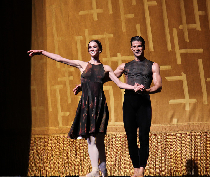Polina Semionova and Marcelo Gomes, Shostakovich Trilogy, June 1, 2013<br /> <br /> Alexei Ratmansky's Shostakovich Trilogy is an exciting, complex, multifaceted work with never a dull moment. Trilogy premiered on Friday, May 31, 2013.  I saw the premier and the Saturday evening performance, which had the same cast. There is a lot going on in the three pieces and it would be difficult to take in all of the action with just one viewing.  I look forward to seeing it in future seasons as even two viewings is not enough to absorb all of the nuances in this fast-paced ballet. Ratmansky's stage is a busy one, with dancers constantly darting in and out of the action, with changing groups and combinations of dancers. <br /> <br /> The work consists of three seemingly unrelated pieces; if they are related, I missed the linkage. The first is Symphony #9, which premiered at City Center in October 2012. The scenery by George Tsypin consists of drawings of World War I-type airplanes, blimps, and  people, some carrying red flags. The two performances I saw featured Polina Semionova and Marcelo Gomes, Herman Cornejo, and Simone Messmer and Craig Salstein. Polina and Marcelo are a great pair and perfectly matched-I saw them in Symphony in C  earlier in the 2013 season. She is becoming one of my favorites at ABT. There are several lighter moments in their dancing with playful movements, demonstrating a sense of humor from Ratmansky. Herman is incredible; in one notable section he performs multiple entrechat six (six beats), each very clean with clear leg separation on the first two leg crossings (four beats), with an exaggerated separation on the last crossing. Very nice. He continues the beats while jumping to stage right and off the stage. Craig Salstein is very expressive and adds a slightly comedic touch. <br /> <br /> The second piece is Chamber Symphony and features David Hallberg-dressed in a jacket with no shirt-as a lost, tormented soul, desperately searching for something.