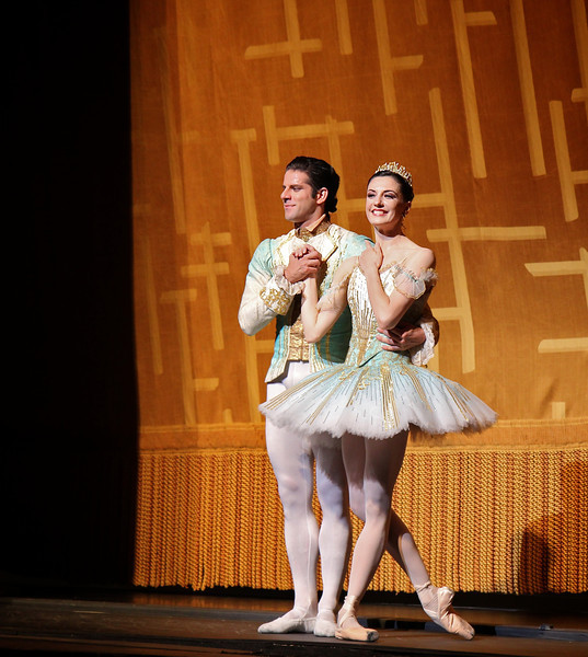 Veronika Part and Marcelo Gomes, Sleeping Beauty, July 6, 2013<br /> <br /> Veronika Part was spectacular as Aurora in ABT's final Met performance of 2013 of Sleeping Beauty. From the moment she appeared on the balcony and descended the stairs to join her 16th birthday party, Veronika took command of the stage with energy, confidence, and style with precise technique and grace, taking full advantage of her long, pure, elegant line and nice turnout and extension. I have not seen Aurora performed this well in a long time. <br /> <br /> Veronika performed the difficult Rosa Adagio nicely with great control and confidence. Some dancers perform this adagio well but with a nervous look of an impending root canal; from my vantage point she did not display any anxiety before or during the adagio. During her balances, she raised her arms to fifth en haut (arms above her head) with a pause before placing her hand down to her next prince. Some dancers do not raise their arms to fifth position, but quickly and anxiously grab the hand of the next partner in desperation. Not Veronika as there were no rough edges Saturday evening. After the adagio in the forest scene, she performed a nice solo with ronde de jambe to a jete diagonal that was uniquely done. Also notable during the pas de deux solo was the way she moved her hands in sync to the beautiful music. <br /> <br /> Marcelo Gomes perfectly complemented Veronika as Prince Desire. He also has a nice long line and great extension. He is a perfect prince as he showered attention to his new love, beaming in admiration. He partnered her effortlessly throughout and his solos were also graceful with nice deep plies ending in a tight fifth position on his tours and jumps. He makes dancing look very easy, a sign of a great dancer. <br /> <br /> Stella Abrera was also very good as the Lilac Fairy. She was particularly convincing in Act II when she convinces Prince Desire to stay in the mysterious forest by granting him a vision of Aurora's beauty. With the Lilac Fairy's help, the prince defeats the evil Carabosse (Martine Van Hamel) and awakens Aurora with a kiss and the spell is broken. The three dancers do a remarkable job describing the story with expressive gestures and mime.<br /> <br /> I was happy to see Misty Copeland as Princess Florine in the Bluebird pas de deux with Blaine Hoven, I haven't seen Misty dance much this year; she was light, energetic, and airy as a bird. Blaine did a fine brise vole beat diagonal that epitomizes the Bluebird solo, capped off by double tours with arms in fifth en haut (arms raised above his head). <br /> <br /> Sad to see the ABT season end. I hope you enjoyed my curtain call photographs and commentary. I make the photos available through a Creative Commons copyright. You may use the photos for non-commercial purposes such as blog posts, Facebook posts, tweets, etc as long as you provide attribution to my website. Wouldn't a photo of Roberto, Marcelo, or Veronika make a nice desktop background photo on your computer? You can't beat the price (free). I will now focus on houses of worship and landscapes in the short term; longer term, maybe a dance/photography blog. I will keep you posted on Twitter. Thanks for tuning in. Kent