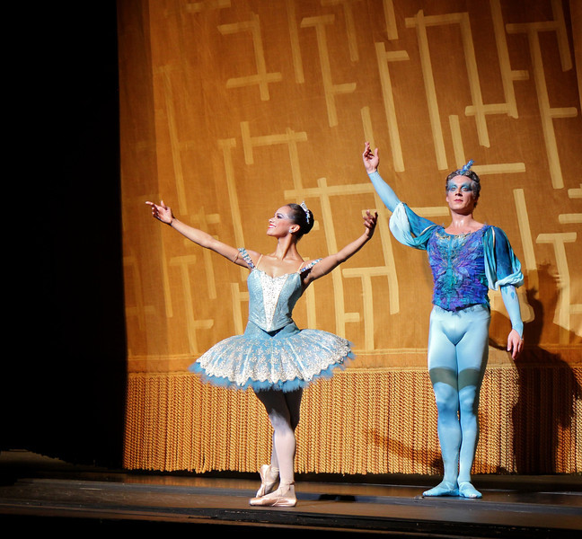 Misty Copeland and Blaine Hoven, Sleeping Beauty, July 6, 2013<br /> <br /> Veronika Part was spectacular as Aurora in ABT's final Met performance of 2013 of Sleeping Beauty. From the moment she appeared on the balcony and descended the stairs to join her 16th birthday party, Veronika took command of the stage with energy, confidence, and style with precise technique and grace, taking full advantage of her long, pure, elegant line and nice turnout and extension. I have not seen Aurora performed this well in a long time. <br /> <br /> Veronika performed the difficult Rosa Adagio nicely with great control and confidence. Some dancers perform this adagio well but with a nervous look of an impending root canal; from my vantage point she did not display any anxiety before or during the adagio. During her balances, she raised her arms to fifth en haut (arms above her head) with a pause before placing her hand down to her next prince. Some dancers do not raise their arms to fifth position, but quickly and anxiously grab the hand of the next partner in desperation. Not Veronika as there were no rough edges Saturday evening. After the adagio in the forest scene, she performed a nice solo with ronde de jambe to a jete diagonal that was uniquely done. Also notable during the pas de deux solo was the way she moved her hands in sync to the beautiful music. <br /> <br /> Marcelo Gomes perfectly complemented Veronika as Prince Desire. He also has a nice long line and great extension. He is a perfect prince as he showered attention to his new love, beaming in admiration. He partnered her effortlessly throughout and his solos were also graceful with nice deep plies ending in a tight fifth position on his tours and jumps. He makes dancing look very easy, a sign of a great dancer. <br /> <br /> Stella Abrera was also very good as the Lilac Fairy. She was particularly convincing in Act II when she convinces Prince Desire to stay in the mysterious forest by granting him a vision of Aurora's beauty. With the Lilac Fairy's help, the prince defeats the evil Carabosse (Martine Van Hamel) and awakens Aurora with a kiss and the spell is broken. The three dancers do a remarkable job describing the story with expressive gestures and mime.<br /> <br /> I was happy to see Misty Copeland as Princess Florine in the Bluebird pas de deux with Blaine Hoven, I haven't seen Misty dance much this year; she was light, energetic, and airy as a bird. Blaine did a fine brise vole beat diagonal that epitomizes the Bluebird solo, capped off by double tours with arms in fifth en haut (arms raised above his head). <br /> <br /> Sad to see the ABT season end. I hope you enjoyed my curtain call photographs and commentary. I make the photos available through a Creative Commons copyright. You may use the photos for non-commercial purposes such as blog posts, Facebook posts, tweets, etc as long as you provide attribution to my website. Wouldn't a photo of Roberto, Marcelo, or Veronika make a nice desktop background photo on your computer? You can't beat the price (free). I will now focus on houses of worship and landscapes in the short term; longer term, maybe a dance/photography blog. I will keep you posted on Twitter. Thanks for tuning in. Kent