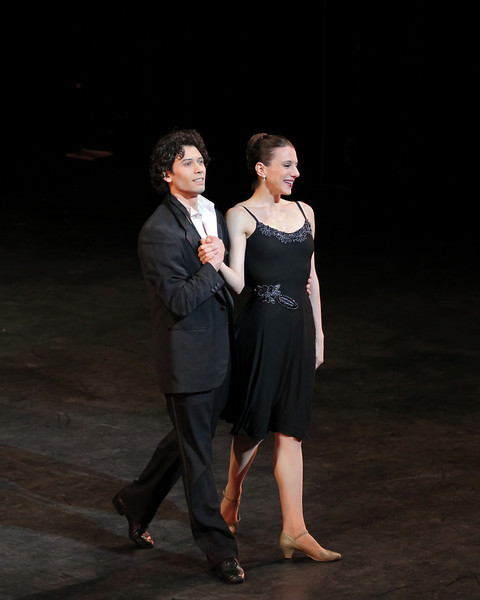 """Herman Cornejo and Luciana Paris, Sinatra Suite, September 17, 2013 <br><br> I knew that the Roberto Bolle and Friends Gala Tuesday at New York's City Center would be a popular event when I walked past the long line of people waiting in the ticket reserve line. Those waiting were not disappointed as the evening featured a diversity of dancing from Roberto and his friends, many from German ballet companies. The evening consisted of 11 unrelated pieces ranging from modern to classical, of which Roberto danced in four.  <br><br> The evening opened with a pas de deux from the full-length ballet Excelsior. I don't know much about the ballet; it is a tribute to the scientific and industrial progress of the 19th century, from the electric light to the telegraph, steam engine, and Suez Canal, according to Wikipedia. Roberto was in skimpy attire (basically a decorated dance belt) while Alina Somova from the Mariinsky Theatre wore a more traditional white ballet dress. The partnering section was fairly short followed by solos featuring fine, controlled jetés, sauté de basques, and coupe jetés from Roberto. Somova ha  a turn section consisting of single and double fouettés and she made it through the section. Well danced but not my favorite performance of the evening.  <br><br> Excelsior was followed by the Act I Romeo and Juliet pas de deux with Alicia Amatriain and Jason Reilly of the Stuttgart Ballet. It was clear that they have partnered together as young, star-crossed lovers in this Cranko (Stuttgart Ballet) version. Filled with emotion and brimming with excitement, the two lovers proclaimed their everlasting love.  <br><br> I've always liked Luciana Paris at American Ballet Theatre (ABT) and would like to see her dance more; happy to see that she is one of Roberto's friends, paired up with another favorite, Herman Cornejo in Twyla Tharp's Sinatra Suite. She always excels in this role at ABT along with another Tharp piece """"In the Upper Room."""" Not sure why she does not get"""