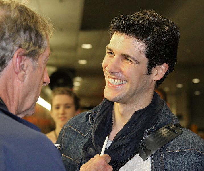 Roberto Bolle, Sylvia, June 28, 2013<br /> <br /> Roberto chats with a fan after the performance<br /> <br /> I had extra time after the Friday performance and stopped by the door where the dancers exit in the underground parking lot at Lincoln Center. I heard that some fans linger for an opportunity to see their favorite dancers and wanted to see what it was all about. <br /> <br /> There were about 30-50 people milling about Friday evening. Polina came out about 20 minutes after the performance to a large ovation. She was very gracious and patient, posing with her fans and signing numerous autographs.<br /> <br /> Roberto came out about 10 minutes later and was particularly considerate and cordial. Some wanted an autograph, photo, or a brief chat-essentially an additional connection with him after a great performance. After satisfying all of the demands of his fans, he waved goodbye and slowly walked away into the Manhattan evening.