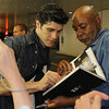 Roberto Bolle, Sylvia, June 28, 2013<br /> <br /> Roberto autographs a book for for a fan<br /> <br /> I had extra time after the Friday performance and stopped by the door where the dancers exit in the underground parking lot at Lincoln Center. I heard that some fans linger for an opportunity to see their favorite dancers and wanted to see what it was all about. <br /> <br /> There were about 30-50 people milling about Friday evening. Polina came out about 20 minutes after the performance to a large ovation. She was very gracious and patient, posing with her fans and signing numerous autographs.<br /> <br /> Roberto came out about 10 minutes later and was particularly considerate and cordial. Some wanted an autograph, photo, or a brief chat-essentially an additional connection with him after a great performance. After satisfying all of the demands of his fans, he waved goodbye and slowly walked away into the Manhattan evening.