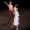 "Erika Gaudenzi and Roberto Bolle, Arlesienne, September 17, 2013 <br><br> I knew that the Roberto Bolle and Friends Gala Tuesday at New York's City Center would be a popular event when I walked past the long line of people waiting in the ticket reserve line. Those waiting were not disappointed as the evening featured a diversity of dancing from Roberto and his friends, many from German ballet companies. The evening consisted of 11 unrelated pieces ranging from modern to classical, of which Roberto danced in four.  <br><br> The evening opened with a pas de deux from the full-length ballet Excelsior. I don't know much about the ballet; it is a tribute to the scientific and industrial progress of the 19th century, from the electric light to the telegraph, steam engine, and Suez Canal, according to Wikipedia. Roberto was in skimpy attire (basically a decorated dance belt) while Alina Somova from the Mariinsky Theatre wore a more traditional white ballet dress. The partnering section was fairly short followed by solos featuring fine, controlled jetés, sauté de basques, and coupe jetés from Roberto. Somova ha  a turn section consisting of single and double fouettés and she made it through the section. Well danced but not my favorite performance of the evening.  <br><br> Excelsior was followed by the Act I Romeo and Juliet pas de deux with Alicia Amatriain and Jason Reilly of the Stuttgart Ballet. It was clear that they have partnered together as young, star-crossed lovers in this Cranko (Stuttgart Ballet) version. Filled with emotion and brimming with excitement, the two lovers proclaimed their everlasting love.  <br><br> I've always liked Luciana Paris at American Ballet Theatre (ABT) and would like to see her dance more; happy to see that she is one of Roberto's friends, paired up with another favorite, Herman Cornejo in Twyla Tharp's Sinatra Suite. She always excels in this role at ABT along with another Tharp piece ""In the Upper Room."" Not sure why she does not get more exposure, but that is a topic for another day. Herman was dashing, debonair in a black tuxedo with Luciana in an elegant black gown as they danced to Sinatra favorites such as ""Strangers in the Night"" and ""My Way."" In ""Strangers in the Night,"" Herman tossed off his jacket with a look of indifference and defiance. In another section, he pulled off seven jazz turns effortlessly. In my favorite part, he danced in an intoxicated manner as Sinatra sings ""one more for the road."" Sinatra Suite was a great selection for the evening and the audience roared with approval. <br><br> Elisa Carrillo Cabrera and Mikhail Kaniskin of Staatsballet Berlin danced in Jeunehomme. This piece, choreographed by Uwe Scholz, was set to music by Mozart. This was a contemporary piece with the dancers are dressed in black. Cabrera and Kaniskin were precise in their intricate movements with Cabrera showing great extension. Their characters seemed frustrated as they were missing and longing for something. Near the end, he walked off the stage, and she was lost without him. He reappeared at the end and they embraced. I liked this piece with difficult partnering sequences, one of my favorites of the night.  <br><br> My least favorite was Le Grand Pas de Deux with Roberto and Alicia Amatriain of the Stuttgart Ballet. This was a silly, stupid, and a pointless comedy piece in which Amatriain walked down the aisle in the beginning on her way to the stage wearing glasses and toting a purse. Roberto was in a Nutcracker type costume. It was classical ballet interspersed with disco. In one section, Alicia completed a very good series of fouettés only to stagger around stage on the verge of vomiting while Roberto was working on a turn section in second position. Not sure why this was put in the program but some in the audience were amused. <br><br> Roberto and Erika Gaudenzi, listed in the program as a Young Italian Talent, Opera House, Rome, opened the second part of the evening with a dramatic pas de deux from L'Arlesienne. I am not familiar with the ballet so it was difficult to follow what was going on. He seemed disturbed about something and then removed his shirt. This was a recurring theme in the evening as the men more often than not were shirtless, showing off their toned bodies. Roberto danced a long introspective, wandering solo that was very well done.  <br><br> Kazimir's Colours with Elisa Carrillo Cabrera and Mikhail Kaniskin were next, set to music by Shostakovich. The music was particularly memorable and dramatic, set to this contemporary piece, with the dancers wearing gym attire.  <br><br> When I arrived, I immediately focused in eager anticipation of the Tchaikovsky Pas de Deux by Balanchine with Herman Cornejo and Maria Kochetkova of the San Francisco Ballet. Maria danced with Herman in Swan Lake and Sleeping Beauty, filling in for the injured Alina Cojocaru in the ABT spring season. They make a nice pair, as she is shorter than Herman and light as a feather. Notable parts were Herman's massive double cabriole derrière, high leaps, entrechat six, double assembles, and double tours to the knee. She was very fast in her spunky solo with a jumping arabesque on releve and very rapid turns and fouettés. She was a very proficient turner.  <br><br> Next was a very interesting modern piece, Mona Lisa with Alicia Amatriain and Jason Reilly opening with creaky doors and fog. (The last time I saw fog at City Center was for ABT's In the Upper Room. That evening,  a zealous stagehand in charge of dry ice pumped massive amounts of fog onto the stage, obscuring all of the dancers. After about 10 minutes with screaming from the audience, the curtain closed and the ballet was restarted after the fog lifted.) Rather than me describing it, take a look at this <a href=""http://www.youtube.com/watch?v=GlScLv2Tyz8"">Youtube clip.</a> A very entertaining 8 minutes.  <br><br> What would a gala be like without the Dying Swan, choreographed by Fokine? Alina Somova was the unfortunate swan, dancing in beautiful Russian form. <br><br> Last was Prototype, a solo for Roberto by Massimiliano Volpini.  A large video screen lined the back of the stage with computer-related images of a human body (ultimately Roberto's) and modern techno-type music. The screen then showed various high-tech images with Roberto interacting with the screen, dancing in unison with the images. At one point, the screen showed examples of ballet steps, which Roberto replicated. Off for a costume change into skin-colored trunks. The theme then turned to classical as he danced to Romeo and Juliet and Swan Lake. Off for another costume change into jeans and a jean jacket so he could dance with images of multiple Robertos on the screen. The interplay with Roberto and the images was unique, revealing his great technique and diversity. <br><br> Roberto was joined on stage by the dancers to a well-deserved rousing ovation by the appreciative, full-house crowd."