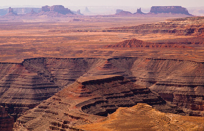 Part of the Goosenecks of the San Juan River with parts of Monument Valley in the distance