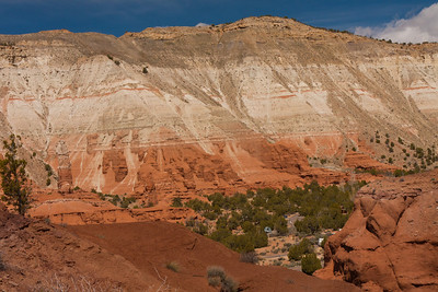 The campground at Kodachrome Basin State Park is surrounded by multicolored cliffs and rock formations.
