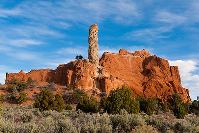 "A monolithic spire known as a sedimentary pipe towers over a red rock formation in Kodachrome Basin. These ""pipes"" are unique to this area."