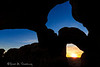 Double Arch at sunset with Balanced Rock and the setting sun framed in the Northern of the arches, in Arches National Park, near Moab, Utah. Captured with a Canon 5D III and 17-40/4.0L in aperture priority mode with an exposure bias of -1 at ISO200, f/13, and 1/40 of a second. The camera was mounted on a Induro CT214 with an AcraTech GP ballhead. The position used to take this photo was quite exposed and I can't recommend the climb/scramble to those not prepared for fourth and easy fifth class climbing (I chose to wear my climbing approach shoes for the added traction).