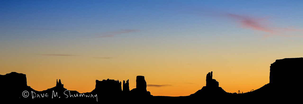 The first light of day paints the sky above Monument Valley, in the Navajo Tribal Park, Arizona. Captured with a Canon 5D III and 70-200/2.8L IS II in aperture priority mode with an exposure bias of 0 at ISO400, f/11, and 1/30 of a second. The camera was resting on a beanbag.