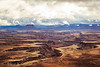 A spring storm breaks over Canyonlands National Park, as seen from The Island in the Sky. Captured with a Canon 5D III and 24-105/4.0L IS in aperture priority mode with an exposure bias of + 1/3 at ISO400, f/11, and 1/320 of a second. The camera was handheld.