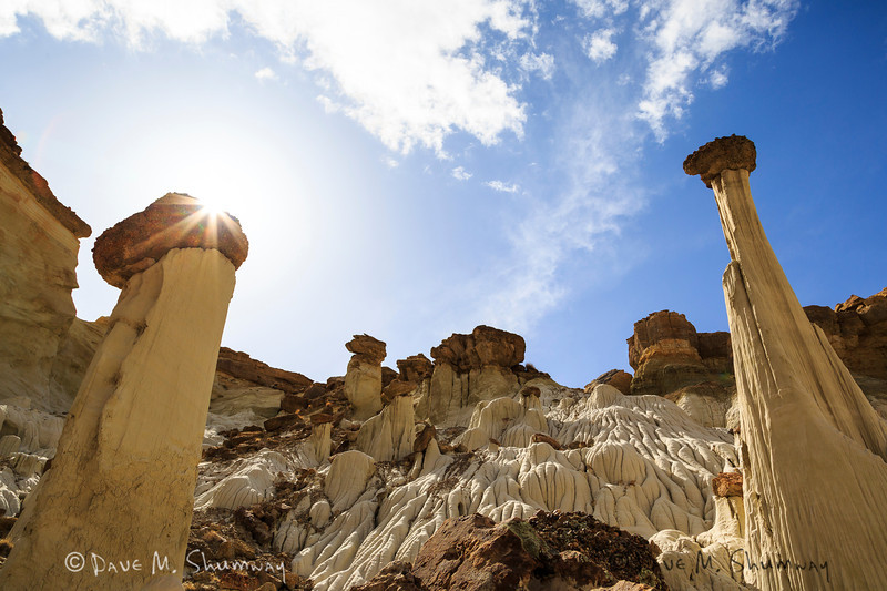 The sun bursts above a hoodoo near the Tower of Silence,in Grand Staircase Escalante-National Monument, Utah. Captured with a Canon 5D III and 24-105/4.0L IS in aperture priority mode with an exposure bias of 0 at ISO200, f/11, and 1/500 of a second. The camera was mounted on an Induro CT214 tripod with an AcraTech GP ballhead.