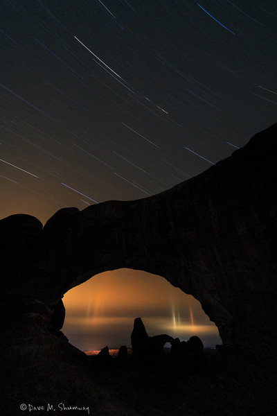 Stars trail above the North Window that frames Turret Arch, in Arches National Park, near Moab, Utah. Captured with a Canon 5D II and 17-40/4.0L in manual mode at ISO100, f/5.6, and about two hours. The camera was mounted on a Gitzo 3540 XLS tripod with an Arca-Swiss Z1sp ballhead.