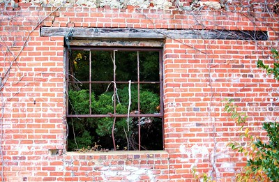 old window in a brick wall
