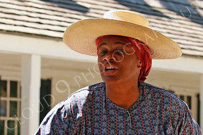 AMER-Slaves 00033 A tight crop portrait of a female slave historical re-enactor with a large rim hat, by Peter J Mancus