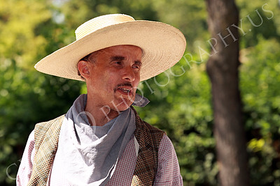 AMER-Slaves 00037 A standing male slave historical re-enactor with a large brim hat, by Peter J Mancus