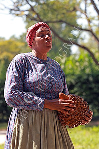 AMER-Slaves 00049 A standing female slave historical re-enactor sings holding a gord, by Peter J Mancus
