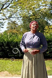 AMER-Slaves 00001 A standing female slave historical re-enactor, by Peter J Mancus