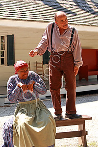 AMER-Slaves 00039 Two slave historical re-enactors act out a slave story, by Peter J Mancus