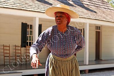 AMER-Slaves 00013 A female slave historical re-enactor manifests stoop labor low back pain, by Peter J Mancus