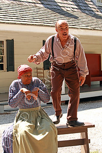 AMER-Slaves 00007 Two slave historical re-enactors act out a slave story, by Peter J Mancus