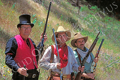 HR-ACB 00006 American cowboy historical reenactor--three cowboys display their firearms, by Peter J Mancus