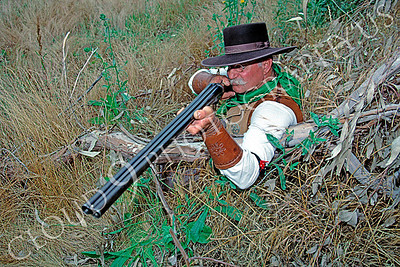 HR-ACB 00010 American cowboy historical reenactor with a big double barrel shotgun by Peter J Mancus