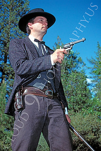 HR-ACB 00009 American cowboy historical reenactor with drawn revolver by Peter J Mancus
