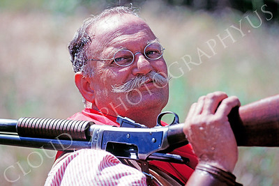 HR-ACB 00001 American cowboy historical reenactor with shotgun on shoulder by Peter J Mancus