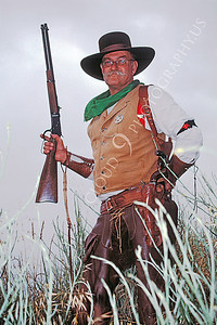 HR-ACB 00011 American cowboy historical reenactor holding lever action rifle by Peter J Mancus
