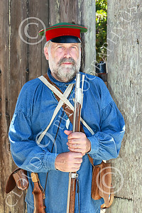 HR-FtRossRUSS 00011 A standing, armed, Ft Ross California male civilian militia Russian settlor historical re-enactor picture by Peter J Mancus