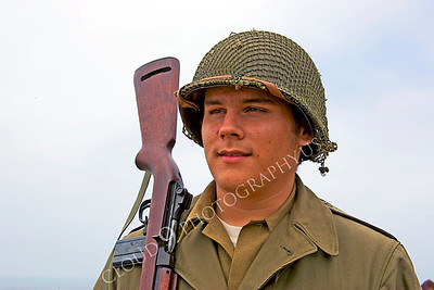 HR-USWWIIA 00001 A US World War II Army soldier reenactor with carbine on shoulder, by Peter J Mancus