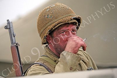 HR - USAWWIIP 00009 An armed, bearded, US Army World War II soldier re-enactor enjoys a smoke by Peter J Mancus
