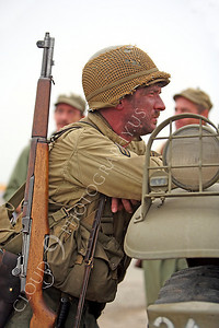 HR - USAWWIIP 00012  An armed US Army World War II soldier re-enactor leans on a truck by Peter J Mancus